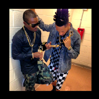 Olamide and Phyno displaying their awards
